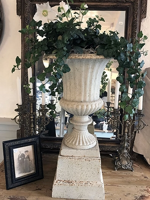 Cast iron vase with stand