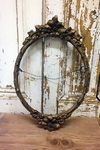 Oval gilt frame
